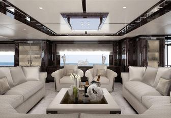 large white sofas and arm chairs in the main salon of luxury yacht Spectre