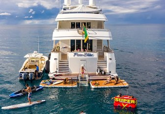 swim platform on superyacht with toys in the water