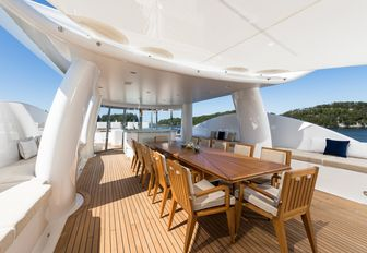 alfresco dining table under cover on the sundeck of superyacht LILI