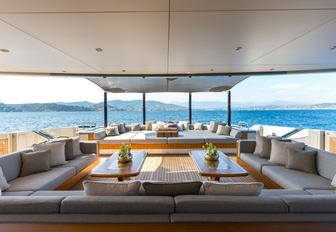 sofas and sunpads on the aft deck of luxury yacht VERTIGE