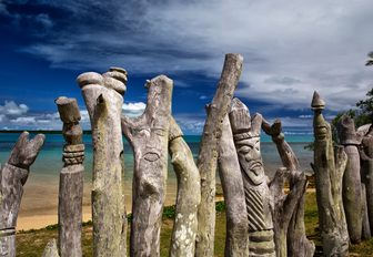 carved totem memorial to European Missionaries on Isle Of Pines, New Caledonia