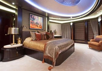 master suite with floor-to-ceiling windows on board luxury yacht KISMET