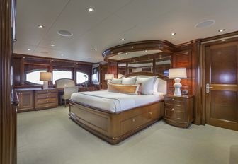large bed in the centre of the full-beam master suite aboard charter yacht Far From It