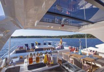 bar, alfresco dining, Jacuzzi and sun loungers on sundeck of luxury yacht Alandrea