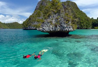 charter guests aboard superyacht LAMIMA go snorkelling when on a luxury yacht charter in Indonesia