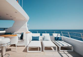Sun loungers on deck of explorer yacht SEAL