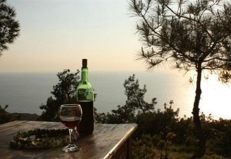 bottle and glass of red wine in Bozcaada, Turkey