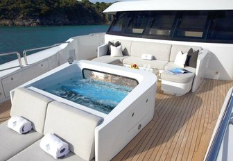 'moon pool', seating area and sun pads on the Portuguese bridge aboard motor yacht Muchos Mas