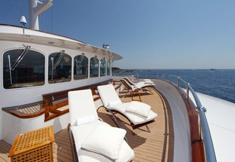 chaise loungers line the deck aboard superyacht SHERAKHAN