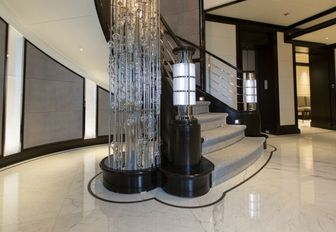 Glass staircase feature on AQUILA yacht