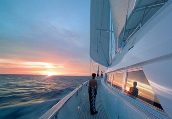 A charterer enjoys the view from the exterior of sailing yacht Spirit of the C's