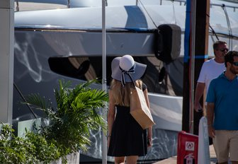 Woman looks at yacht during FLIBS 2019