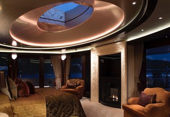 master suite with skylight and fireplace on board superyacht KISMET