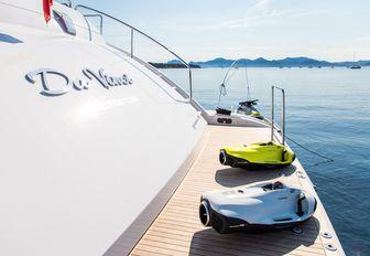 seabobs line up on the swim platform of charter yacht Da Vinci