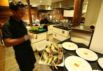 Chefs in the galley of yacht LAMIMA