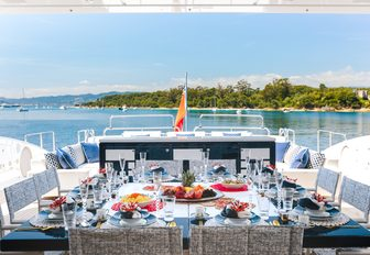 alfresco dining setup on the sundeck of luxury yacht Da Vinci