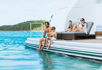 guests on board charter yacht titania having fun and enjoying their self isolation experience while on their luxury yacht charter vacation in Greece