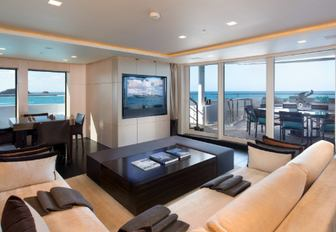 sofa and games table in the skylounge of motor yacht SIREN