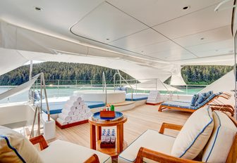 sundeck and jacuzzi on superyacht party girl, with towels and little coffee table