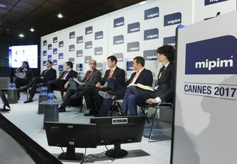 speakers take part in a conference at MIPIM