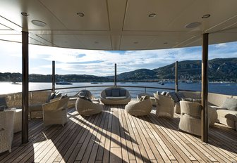 Selection of comfortable chairs on deck of Superyacht CHAKRA