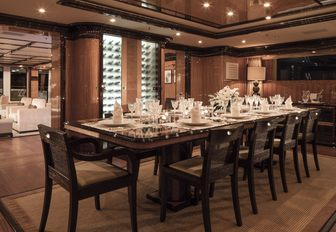 formal dining table set for dinner party aboard charter yacht MEAMINA