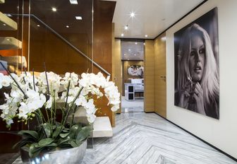 chic and contemporary hallway with huge photograph of model aboard charter yacht MISCHIEF