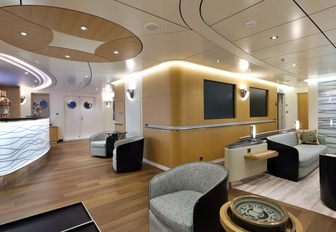 superyacht yersin main salon, with seating area and backlit bar