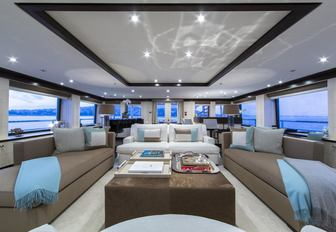 light and airy skylounge with grand piano aboard luxury yacht 4YOU