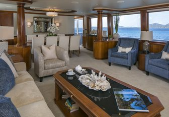 main salon with welcoming lounge aboard superyacht 'Chasing Daylight'