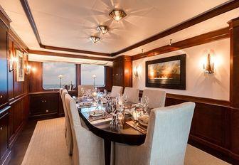 formal dining salon in modern-classic style aboard luxury yacht PIONEER