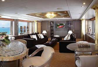 light and airy skylounge with mosaic-topped bar on board motor yacht DENIKI