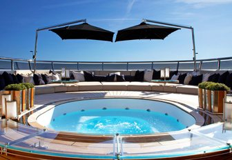 inviting Jacuzzi surrounded by sunpads on the sundeck of luxury yacht SEALYON