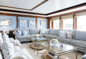 tranquil salon with sumptuous seating on board charter yacht TITANIA