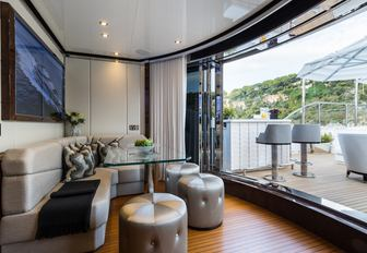 cosy nook on board charter yacht 11/11 opens onto deck area with bar