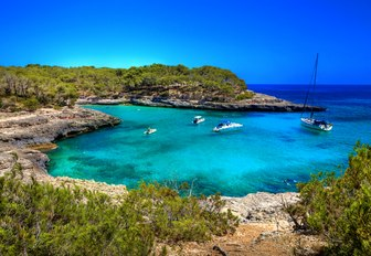 Secluded cove with yachts and blue sky