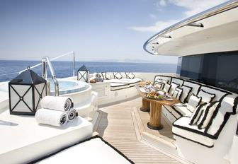 a Jacuzzi and seating forward of the master suite on board motor yacht 'Alfa Nero'