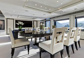 dining table in the light and airy main salon of charter yacht LILI