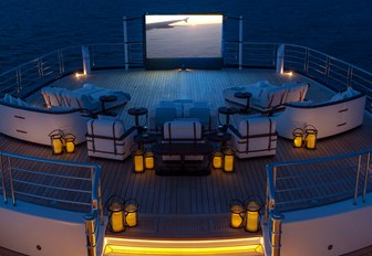 Elevated deck area and outdoor cinema screen on superyacht TIS