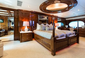 large bed under a skylight in the main salon of superyacht Remember When