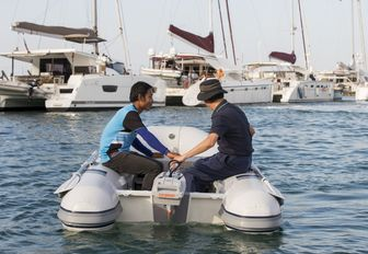 a tender escorts visitors across Royal Phuket Marina at the Thailand Yacht Show & Rendezvous