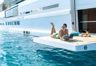 woman social distancing on luxury yacht charter vacation