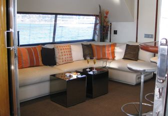 bar and seating area in skylounge aboard motor yacht 'Costa Magna'