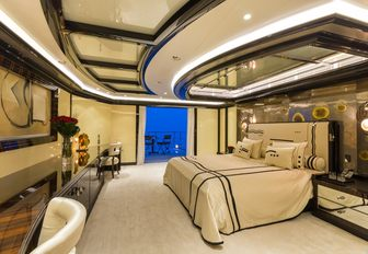 sycamore-clad master suite with drop-down balcony on board luxury yacht OKTO