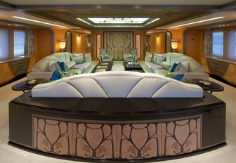 The light blue and green seating found in the main salon of superyacht AMARYLLIS