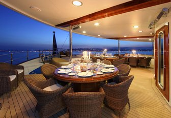 circular dining tables on main deck aft aboard charter yacht SHERAKHAN