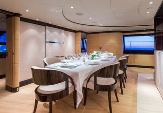 indoor dining area in the main salon aboard luxury yacht Q