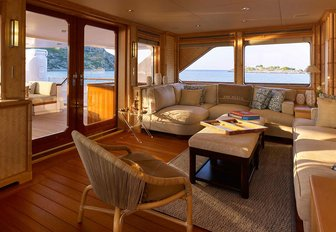 bamboo-clad walls and deep sofas in the skylounge of charter yacht ANCALLIA