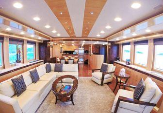 maple and burl walnut main salon aboard charter yacht 'Mystic Tide'