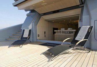 teak beach club with sun loungers aboard motor yacht SIREN
